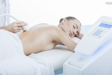 reduction: vacuum massage procedure in the medical beauty center Stock Photo