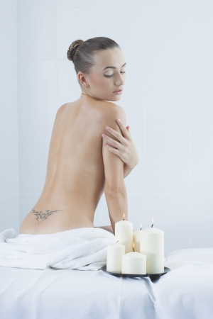beautiful woman in a medical beauty center on massage therapy photo