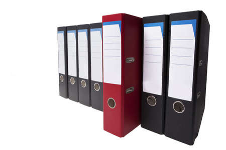 a red ringbinder stands out, it different than the usual Stock Photo - 10715086