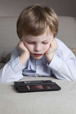 a boy is frustrated of playinig his game photo