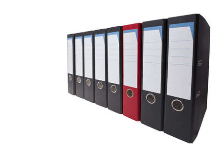 a row of black ringbinders with one different ringbinder Stock Photo - 10959157