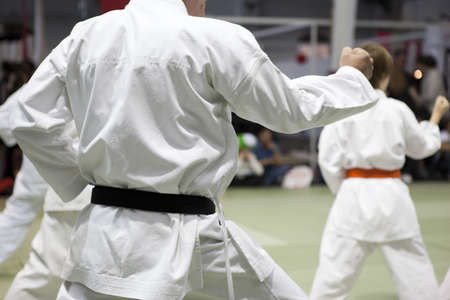 kata: karate training, kata  with punch performed in group Stock Photo