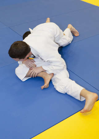 arts and entertainment: Children fighhting in a Brasilian Jiu Jitsu-Graplling tournament