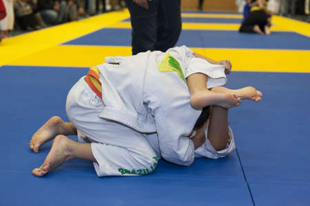 jujitsu: Children fighhting in a Brasilian Jiu Jitsu-Graplling tournament