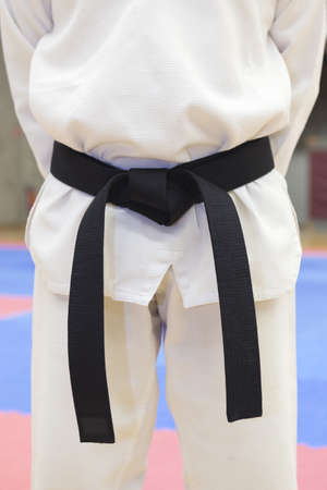 black belt: a men wearing a black belt in taekwondo