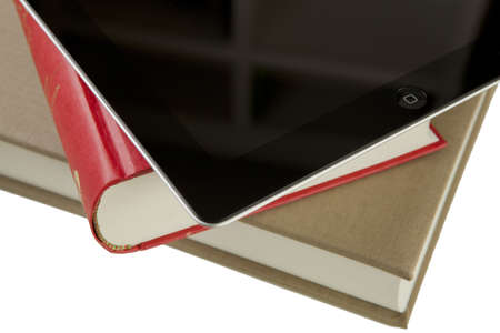 A ipad2 tablet with books on a white background