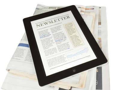 A ipad2 tablet on newspapers with a newsletter  ,on a white background