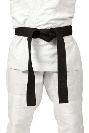 judo: un cinturón negro aislado en blanco Foto de archivo