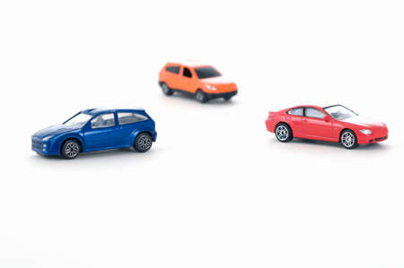 toy cars: three colorful toy cars Stock Photo
