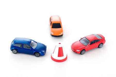 parking space: three colorful toy cars Stock Photo