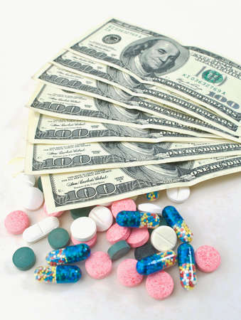 antidepressant: Pills and dollars on a white background