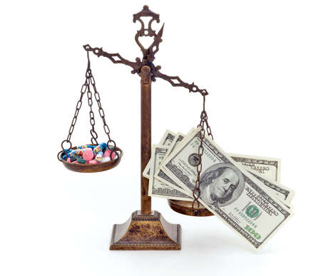 Classic scales of justice with a bunch of pills and dollar