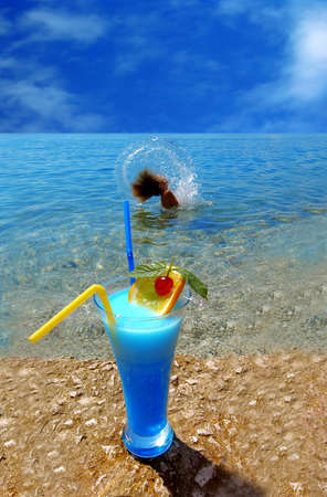 Beautiful fruit cocktail at the sunny beach