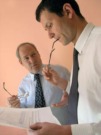 Serious Team.Two businessman from different generations(the focus is on the young man)        Stock Photo