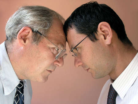 Two businessman from different generations. Conflict of powers.       Stock Photo