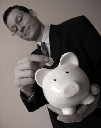 Businessman with a piggy bank Stock Photo - 2644020