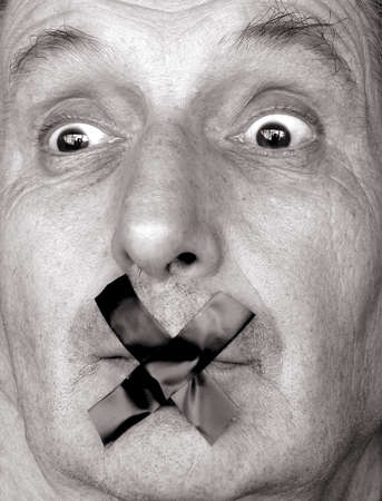 shutup: censure!stop talking! man with adhesive tape over his mouth. sepia tone           Stock Photo