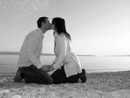 Kiss at the beach    Stock Photo