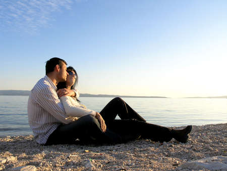 YOUNG COUPLE ON BEACH     Stock Photo