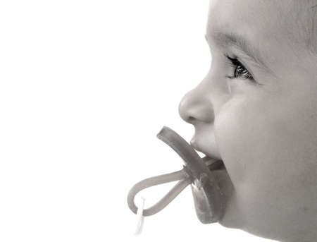 Little boy with dummy. Stock Photo