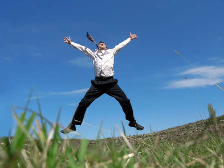 Businessman jumping in the air with success       photo
