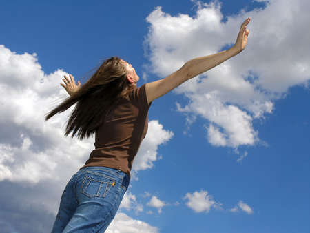 Life is beautiful .Young woman and clouds  .