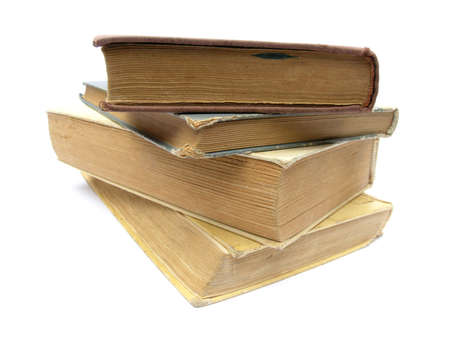 Stack of books on white background.