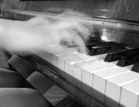 Playing the Piano - shallow DOF      Stock Photo