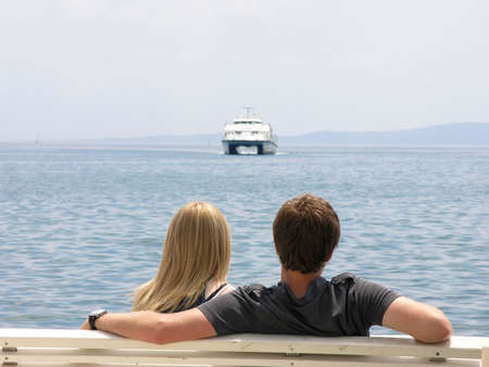 Young couple looking at a ferryboat
