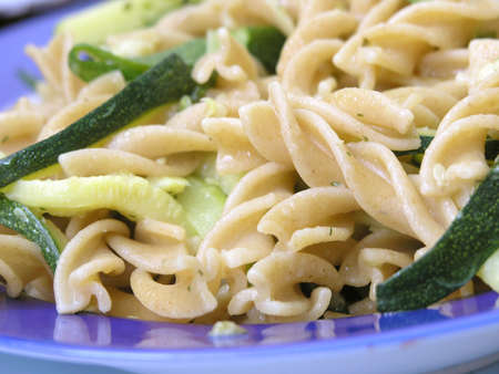 Close up of italian  integral pasta with zucchinis .Shallow DOF