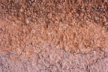loam: Red dry clay loam closeup as background Stock Photo