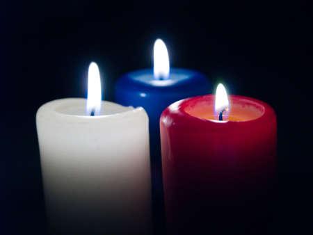 blazes: Burninging candles on black background Stock Photo