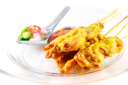 repast: Satay pork on clear dish on white background Stock Photo