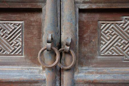 Traditional Chinese Residences interior wooden door and metal door ring in Tianshui Folk Arts Museum Hu Shi folk house, Gansu China
