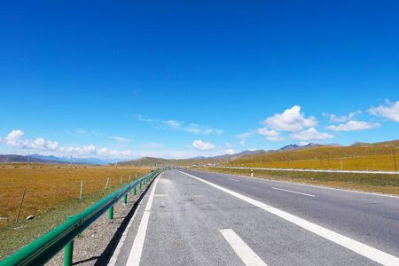 Beautiful landscape view of blue sky and high way road in Qinghai China