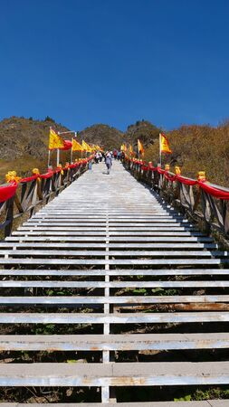 tourist at Heaven Lake of Celestial Mountains and Taoist Heavenly Queen Mother temple in Xinjiang China. 写真素材