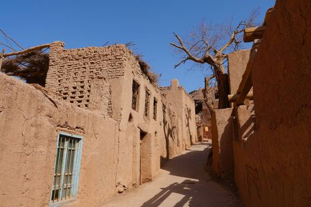 Ancient traditional residential old house village valley inTurpan Xinjiang Province China. 写真素材