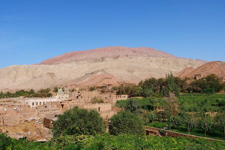 Ancient traditional residential old house village valley in Turpan Xinjiang Province China. 写真素材