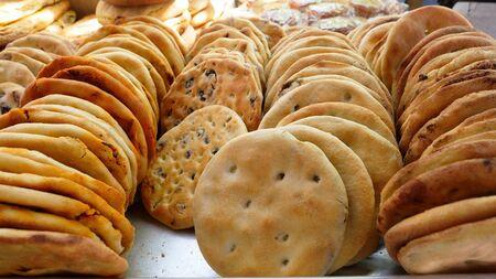 Uyghur bread nang on the table in the international Grand Bazaar, Urumqi Xinjiang China