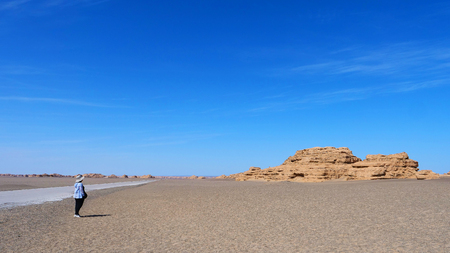 Nature landscape view of Yardang landform under sunny blue sky in Dunhuang Global Geopark, Gansu China.
