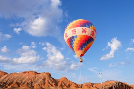 Beautiful nature landscape view of hot air ballon in Zhangyei Danxia Landform, Gansu China. Chinese translation : Danxia landform park.