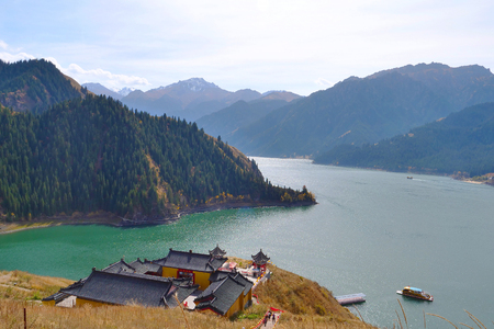 Nature landscape view Heaven Lake of Celestial Mountains and Taoist Heavenly Queen Mother temple in Xinjiang China. Publikacyjne