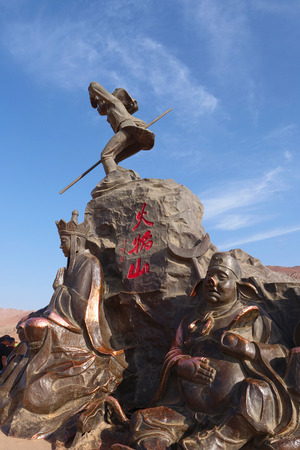 Nature landscape view of the Flaming Mountain statue of The Journey to The West in Turpan Xinjiang Province China. Chinese translation : Flaming mountain. Publikacyjne