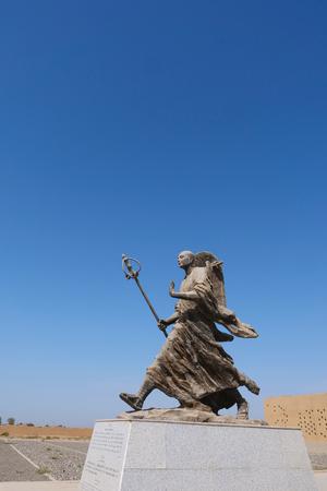 Metal statue of Tang Priest Tang Sanzang in Ruins of Gaochang, Turpan Xinjiang Province China. Redactioneel