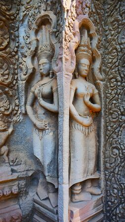 Stone rock carving art at Ta Prohm Temple in Angkor wat complex, Siem Reap Cambodia.