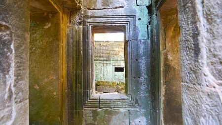 Stone rock ruin window at Ta Prohm Temple in Angkor wat complex, Siem Reap Cambodia.