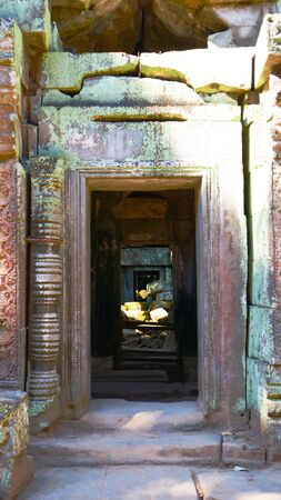 Stone rock ruin door at Ta Prohm Temple in Angkor wat complex, Siem Reap Cambodia.