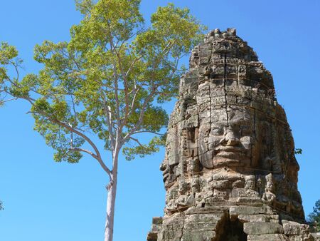 Stone rock carving art of face at Banteay Kdei, part of the Angkor wat complex in Siem Reap, Cambodia