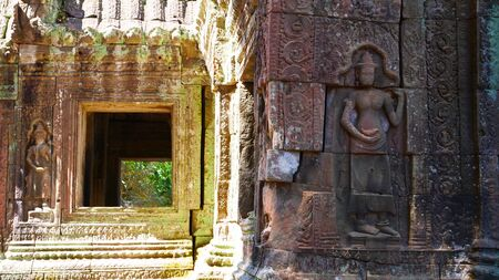 Stone rock carving art at Banteay Kdei, part of the Angkor wat complex in Siem Reap, Cambodia
