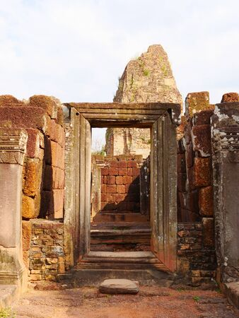 Stone rock door frame at Ancient buddhist khmer temple architecture ruin of Pre Rup in Angkor Wat complex, Siem Reap Cambodia.